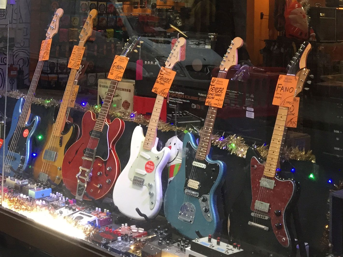 Guitars in a shop window on Denmark Street, London