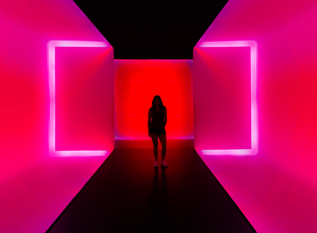 Lady standing in a pink corridor